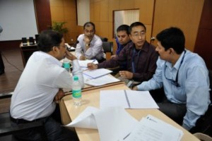 Admissions committee evaluating interviews